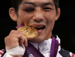 korean wrestler with gold and black eye