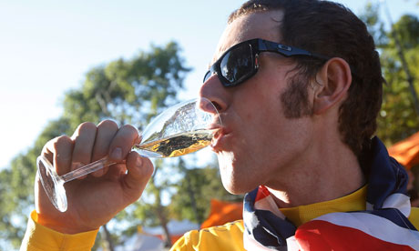 Bradley Wiggins drinks champagne